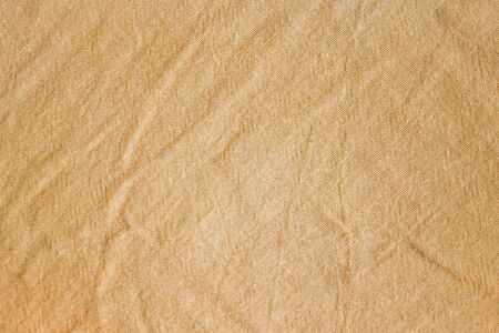 Natural fabric is beige, brown, orange. Cotton clothes burned in the sun. Eco-friendly material.