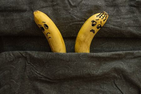 Two bananas in bed, turned in different directions, do not want each other. Coldness, lack of attraction to the husband or wife, disharmony. The picture is made by the author.