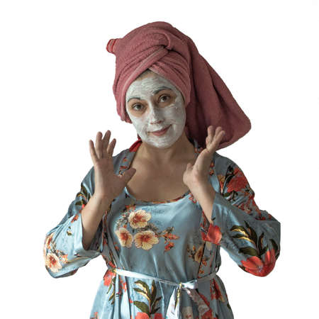 Housewife, woman with a cosmetic mask on her face. Home skin care. Фото со стока