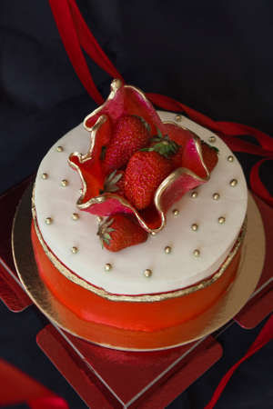 Strawberry Cake with Fresh Berry. Confectionery art, handmade. All the best. Black background. Фото со стока