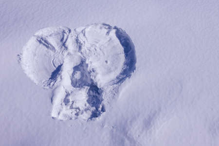 An angel's imprint on a white, snowy surface. Winter, Christmas, the eve of the holiday. Lilac toning, copy space.