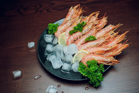 Red shrimp on a wooden board ice papper Argentina Stock Photo