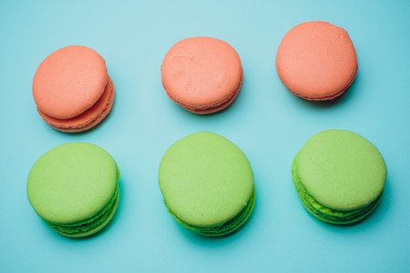 six macaroons on a colored background sweetness green