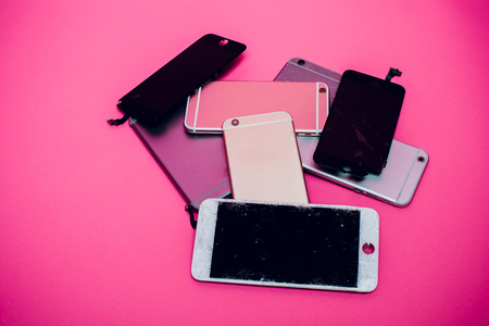 Damaged smartphone Caused by severe shocks. Broken smartphone screen. Phone screen broken in cracks. I like the feel of this, might be something I try to create for my body background pink