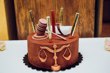 Bride and groom cake topper couple with legal gavel Stock Photo