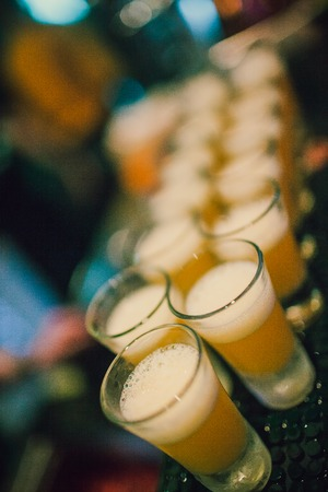 Beautiful row line of different colored alcohol cocktails with mint on a open air party Stock Photo