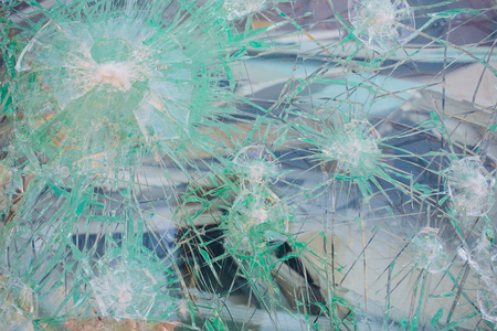 photo broken window looks like a bullet hole