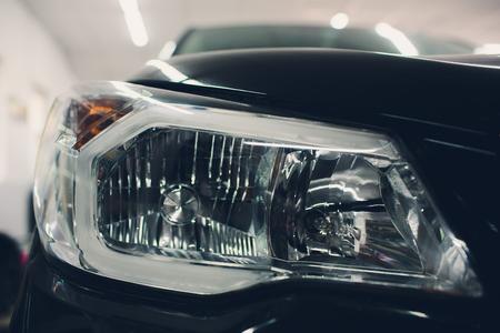 front headlight, with shiny reflections auto black body.