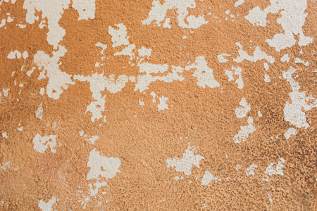texture, background: old concrete wall with peeling plaster and crumbling whitewash