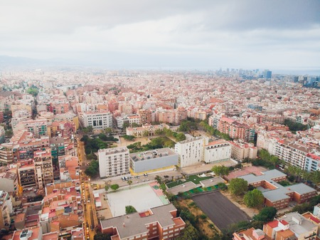 Aerial view of Sants-Montjuic residential district from helicopter. Barcelona Фото со стока
