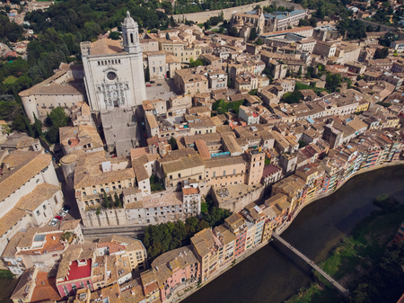 Girona - town in Catalonia, Spain. Onyar River bridge and beautiful, colorful mediterranean architecture. Prominent cathedral