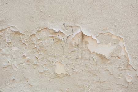 Background texture of the old cracked wall with peeling paint and plaster Stock Photo