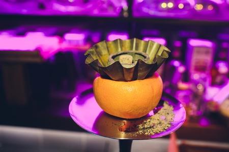 Stylish hookah with the aroma grapefruit for relax. grapefruit shisha. Hookah lounge