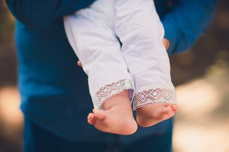 Baby feet in hand. Christening. Baptism Orthodox