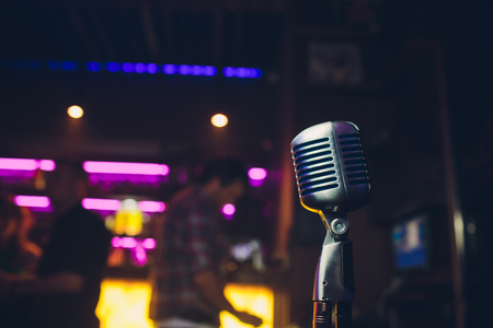 Retro microphone on stage in a pub or American Bar restaurant during a night show