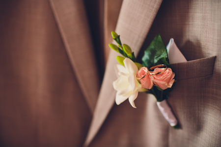 Beautiful boutonniere of the groom. Design a boutonniere. Wedding day Stock Photo