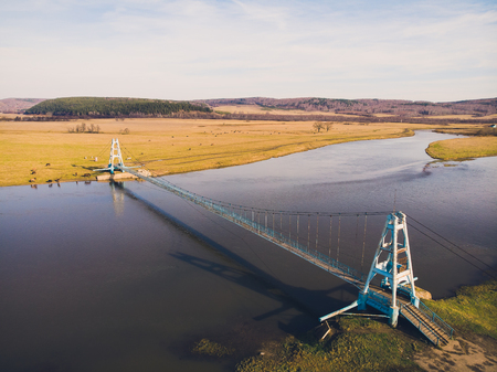 Aerial view of suspension bridge, view from above. Maloyaz, Republic of Bashkortostan. Russia