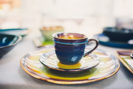 Designer handmade dishes, plates and cups in a stylish boutique