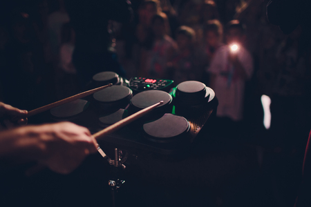 Music reheard group male playing a piano and electronic drum in music room Stock Photo