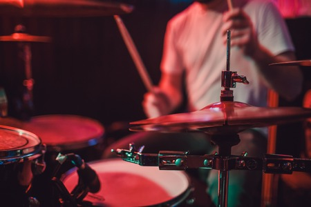Professional drum set closeup. Drummer with drums, live music concert