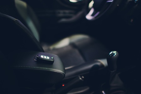 Closeup inside vehicle of wireless key ignition. Modern car Interior details. Car detailing. Keys close up 免版税图像