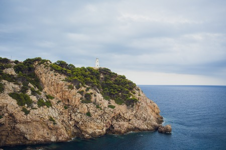 Lighthouse at Cape Formentor in Coast of North Mallorca, Spain. Artistic sunrise and dusk landascape