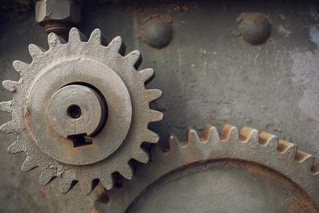 Metallic Rusty industrial machine parts closeup photo.