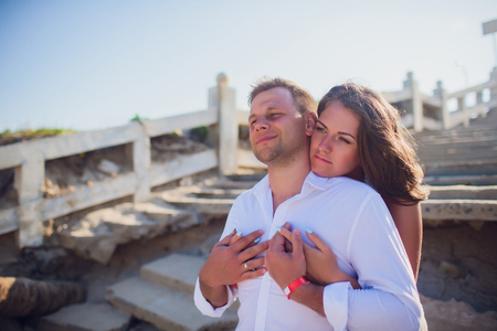 couple photographed on vacation sea, ocean. Against background destroyed Vietnamese staircase Standard-Bild