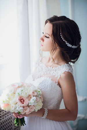 bride hold wedding bouquet of rose peonies and roses. Stock Photo