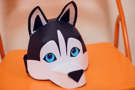 children make masks of husky dogs craft Stock fotó