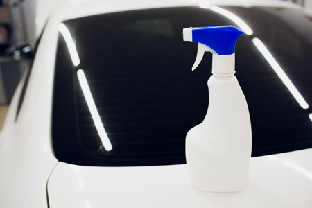 Fluid washer for car window. place for text