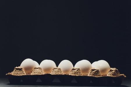 Several white eggs in an egg carton Stock Photo