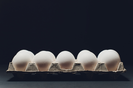 Several white eggs in an egg carton 写真素材
