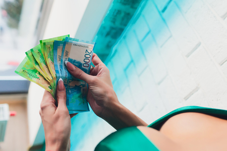 woman body with 2000 rubles banknote in a white lacy brassiere