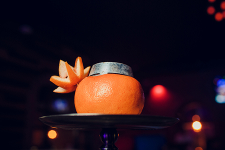 Stylish hookah with the aroma grapefruit for relax. grapefruit shisha Stock Photo