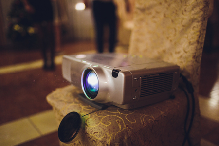 Closeup of projector for presentation in blue light tone