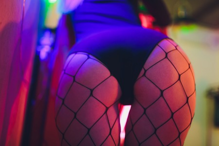 Sexy big ass girl under neon blue light, lifestyle photo