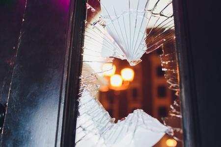 Broken glass black door of the shop