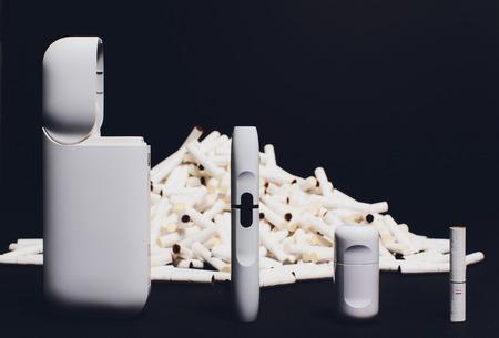 The new technology cigarette, hybrid cigarette, heatsticks, tobacco, new device device cleaning kit. 版權商用圖片