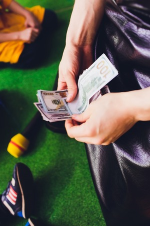 Cash in hands. Profits, savings. Stack of dollars. Man counting money. Dollars in mans hands. A man in business clothes with dollars. Success, motivation, financial flows, wealth. Stack of dollars.