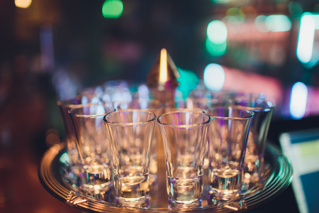 Empty shot glasses on bar counter selective focus