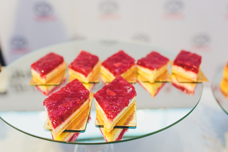 Small cheesecakes on the plate at a wedding candy bar
