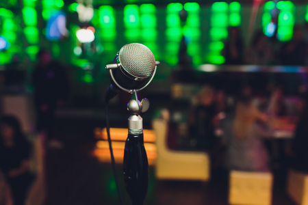 Microphone. Retro microphone. A microphone on stage. A pub. Bar. Restaurant. Classic. Evening. Night show. European restaurant European bar American restaurant American bar