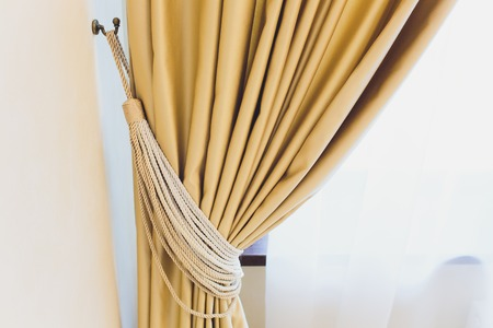 Holder for room curtains. Fragment photo curtain, interior detail, curtain detail close up.