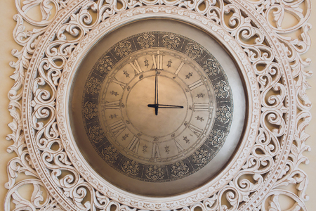 Vintage retro style clock on a wall.