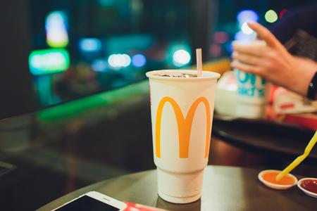 Patong, Thailand - February 22, 2019: Coca Cola paper cup, mcdonalds. Editorial