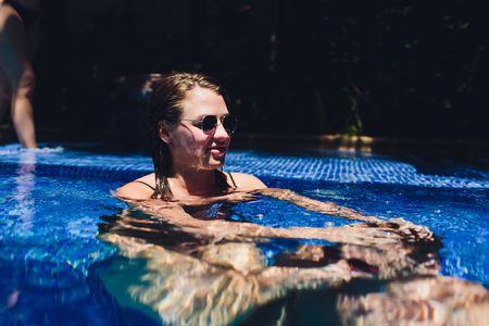 Woman drowns a man in the pool. Stock Photo