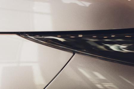 Close Up of a New Car Headlight. 免版税图像