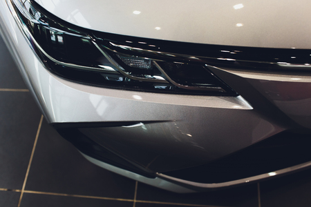 Close Up of a New Car Headlight. Banco de Imagens