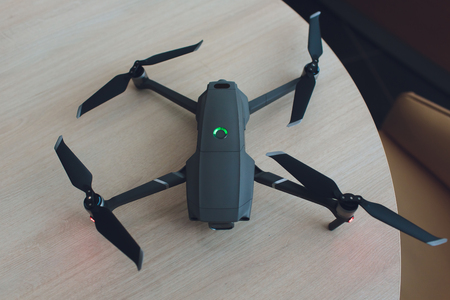 New dark grey drone quadcopter with digital camera and sensors.